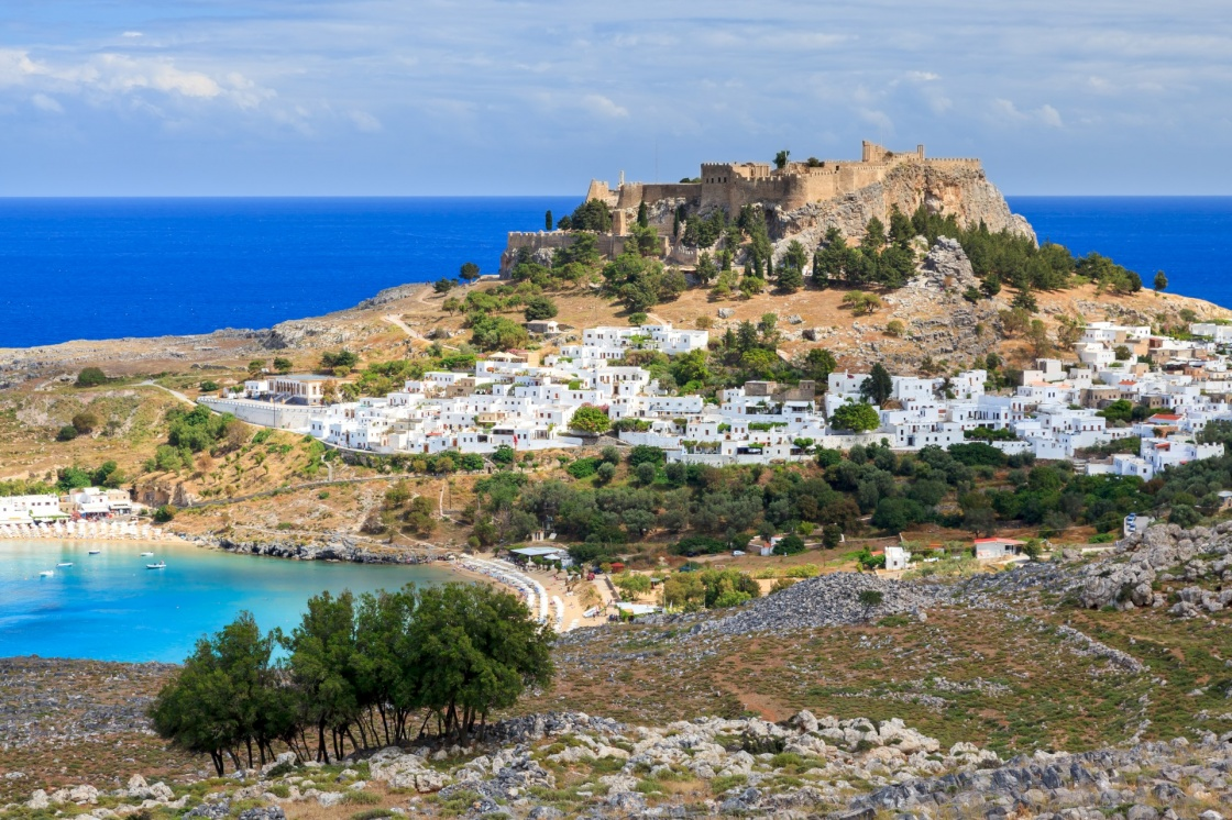 'View from the road down to the popular town of Lindos on the Island of Rhodes Greece' - Rhodes